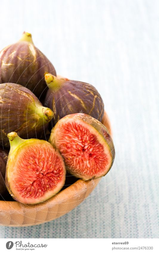 Fresh figs in bowl on blue background Food Fruit Nutrition Breakfast Organic produce Vegetarian diet Diet Natural Blue Red Fig Food photograph Candy Healthy Raw