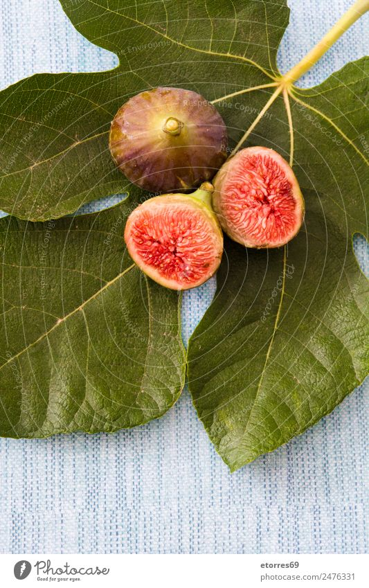Fresh figs on blue background Food Fruit Nutrition Breakfast Organic produce Vegetarian diet Diet Green Red Fig Food photograph Healthy Raw Tropical Vitamin