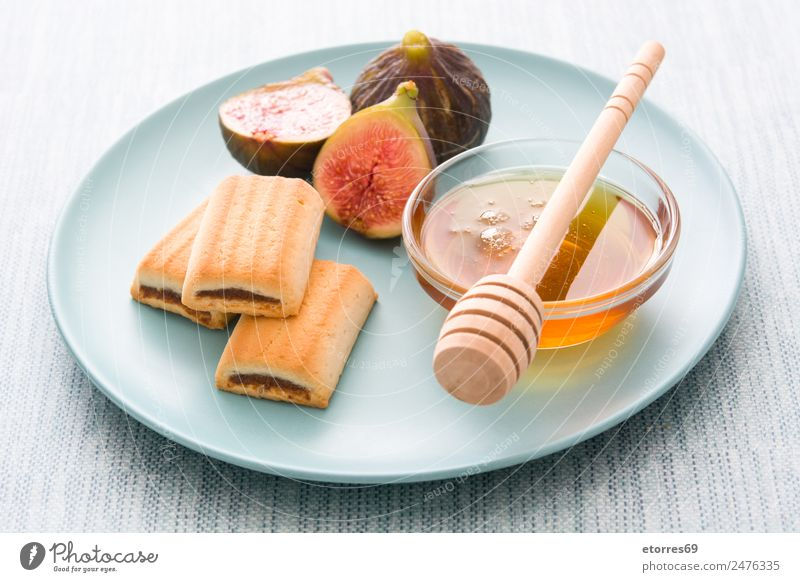 figs cookies and honey on blue background Food Fruit Cake Dessert Nutrition Organic produce Vegetarian diet Diet Blue Yellow Red Fig Cookie Honey Sweet