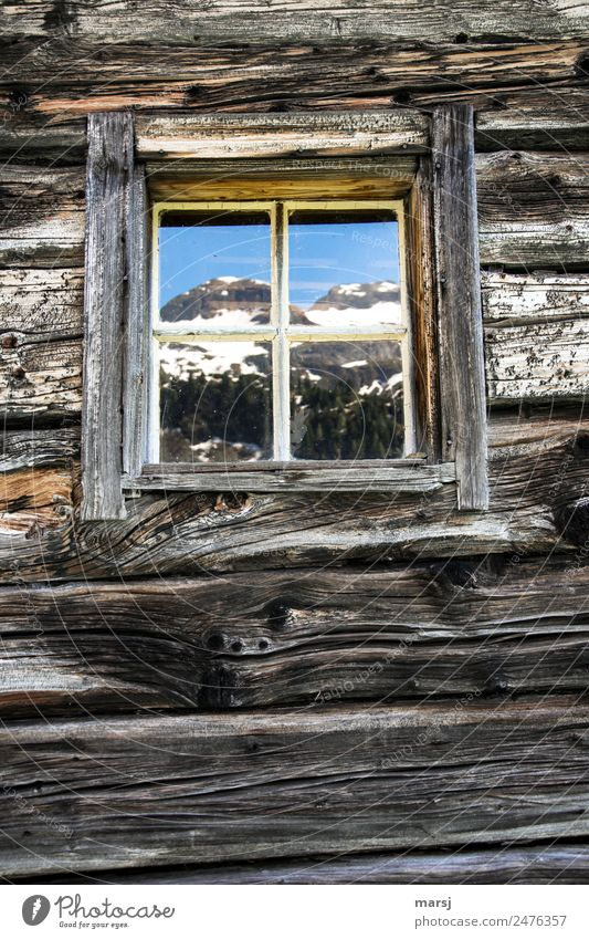 Room with mountain view Sky Spring Alps Mountain Peak Snowcapped peak Hut Wall (barrier) Wall (building) Block plank Wooden wall Window Old Blue Brown Idyll