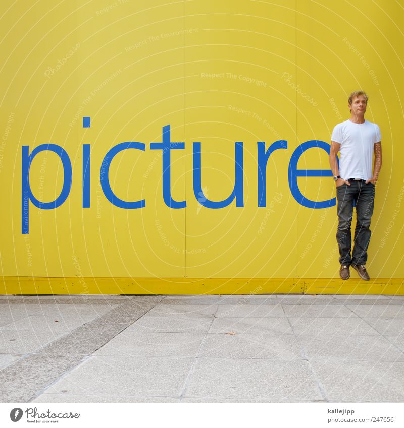 Human being Man Yellow Life Wall (building) Jump Adults Signs and labeling Masculine Characters Image Advertising Hover Photographer English