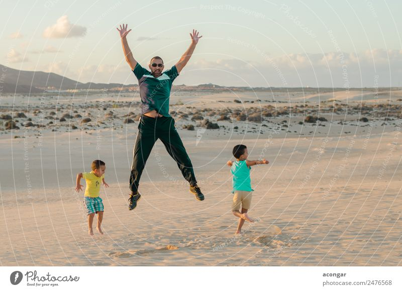 Family jumping on the dunes of Corralejo Joy Happy Relaxation Playing Vacation & Travel Island Child Human being Masculine Boy (child) Young man
