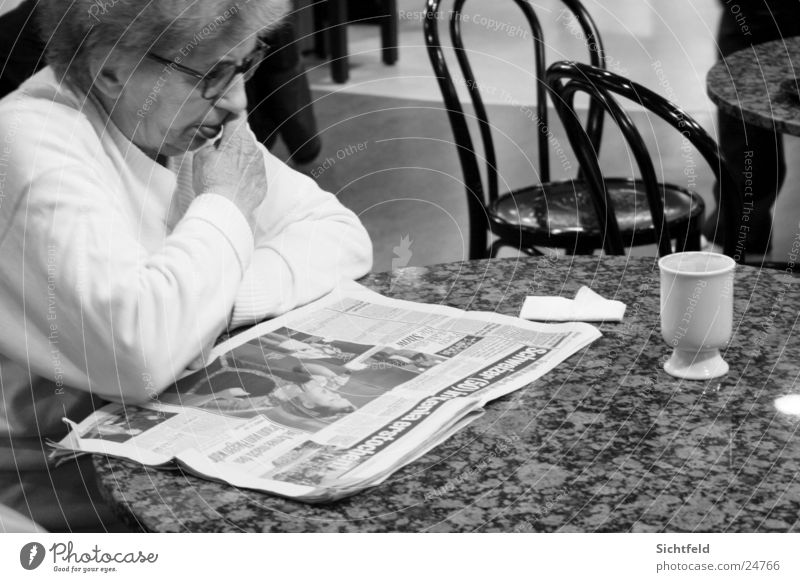 Woman Loneliness Senior citizen Beverage Coffee Drinking Reading Bar Newspaper Tea Grandmother Restaurant Café Female senior Human being Sidewalk café