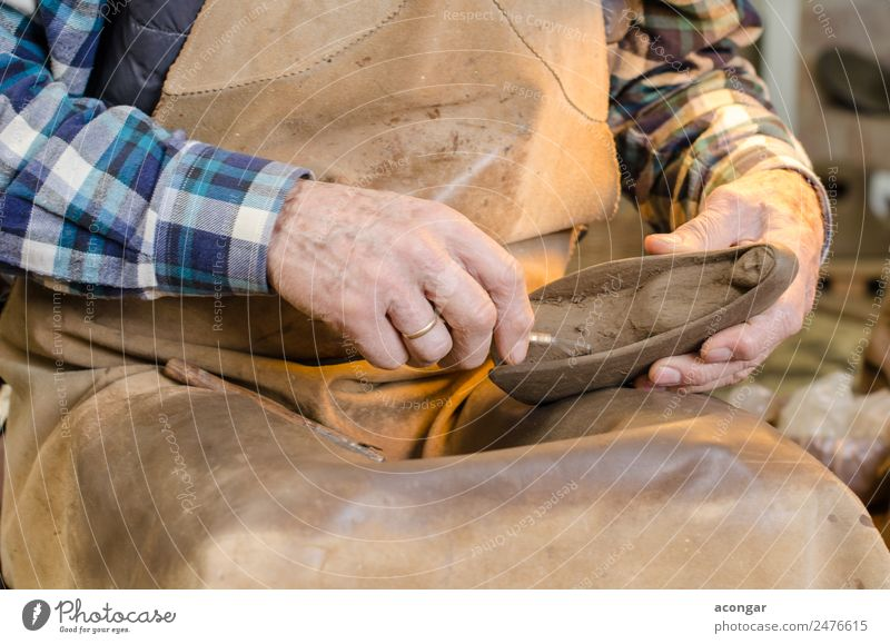 Old hands of a potter shaping a clay figure Design Handicraft Work and employment Profession Craftsperson Tool Art Artist Disciplined ceramic Clay crafts