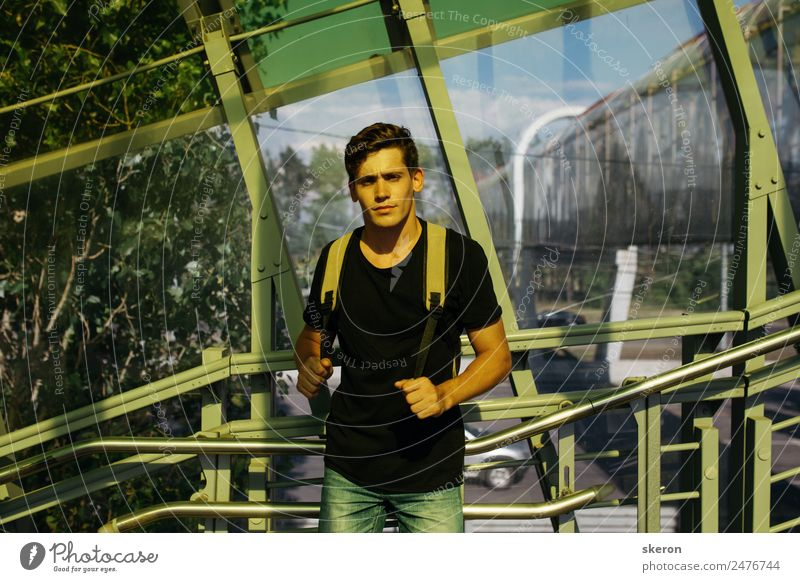 young tourist walks around the summer city Vacation & Travel Youth (Young adults) Summer Young man Far-off places Healthy 18 - 30 years Architecture Lifestyle