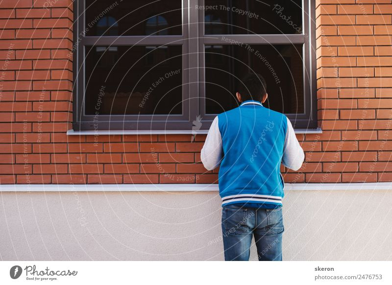 curious guy looks in the window Human being Youth (Young adults) Summer Young man Window 18 - 30 years Architecture Lifestyle Adults Wall (building) Sports
