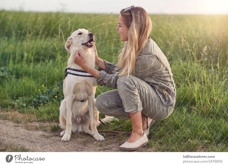 Happy smiling dog with its pretty young owner Lifestyle Joy Beautiful Leisure and hobbies Playing Summer Woman Adults Friendship 1 Human being 18 - 30 years