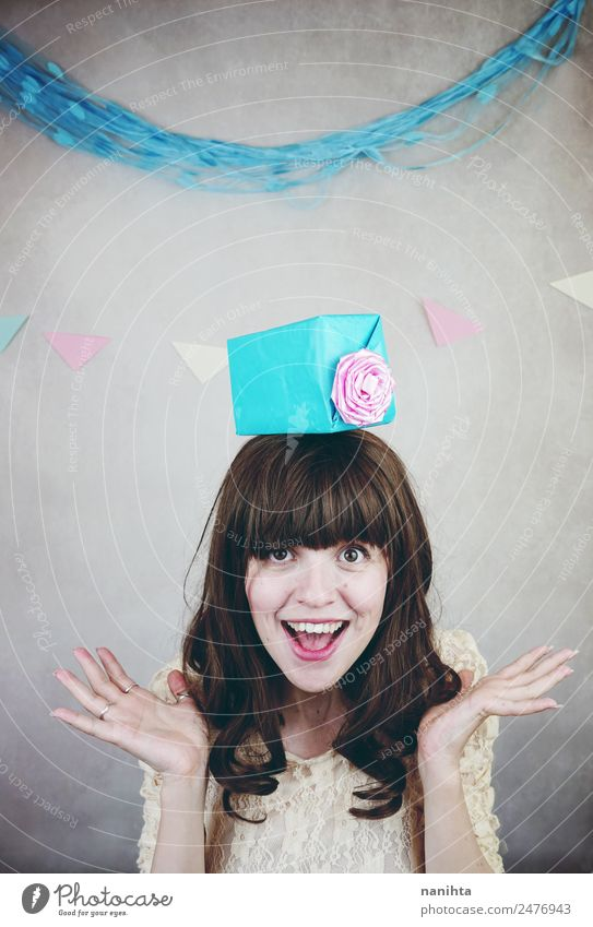 Young cheerful woman with a gift over her head Lifestyle Style Wellness Well-being Party Event Feasts & Celebrations Birthday Human being Feminine Young woman