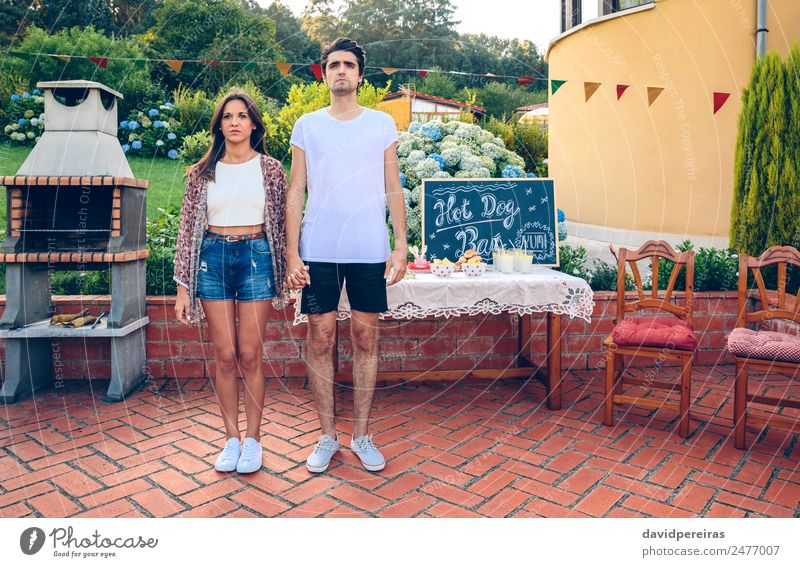 Couple standing in a outdoors summer barbecue Bread Roll Lunch Fast food Beverage Lemonade Lifestyle Joy Relaxation Summer Garden Table Blackboard Human being