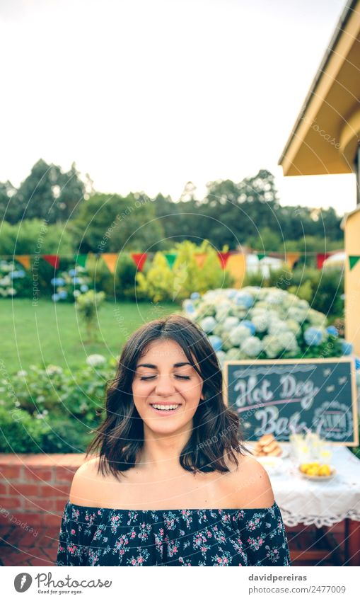 Young woman with closed eyes laughing over nature background Lunch Lemonade Lifestyle Joy Happy Leisure and hobbies Summer Garden Table Blackboard Human being