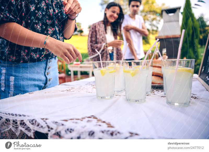 Friends at table with fresh lemonade having fun Beverage Drinking Lemonade Straw Lifestyle Joy Happy Leisure and hobbies Summer Garden Table To talk Woman