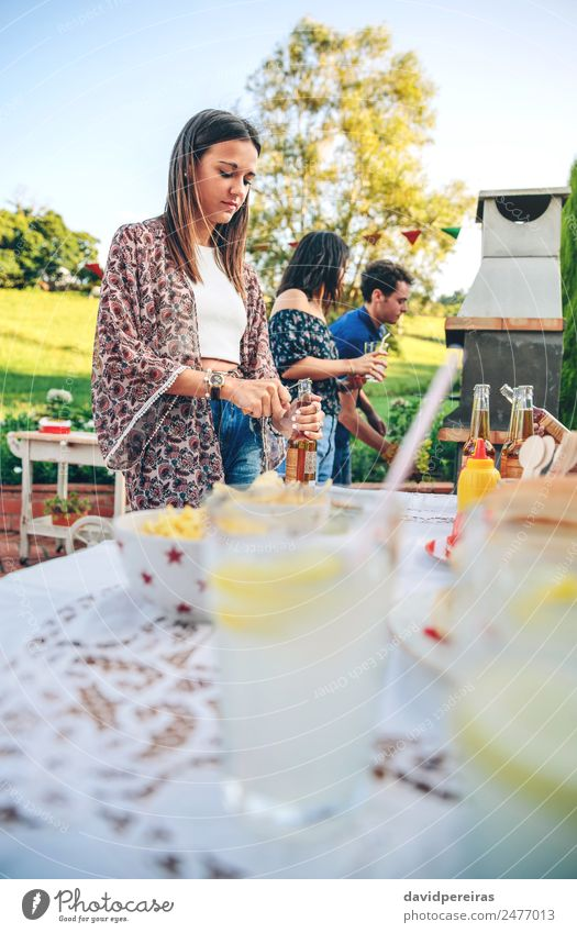 Woman opening beer bottle in summer barbecue Eating Lunch Beverage Lemonade Alcoholic drinks Beer Bottle Straw Lifestyle Joy Happy Leisure and hobbies Summer