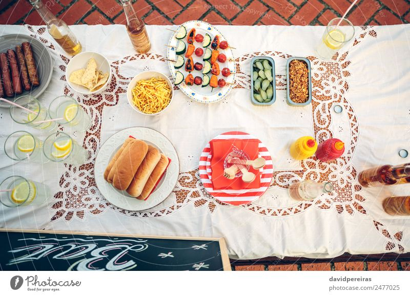 Table with food and drinks in summer party Vegetable Bread Roll Lunch Fast food Beverage Lemonade Beer Plate Bottle Happy Summer To enjoy Fresh Delicious Yellow