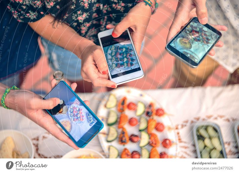 Young hands taking photos with smartphones to vegetable skewers Vegetable Lunch Plate Lifestyle Joy Happy Summer Table Telephone PDA Technology Woman Adults Man