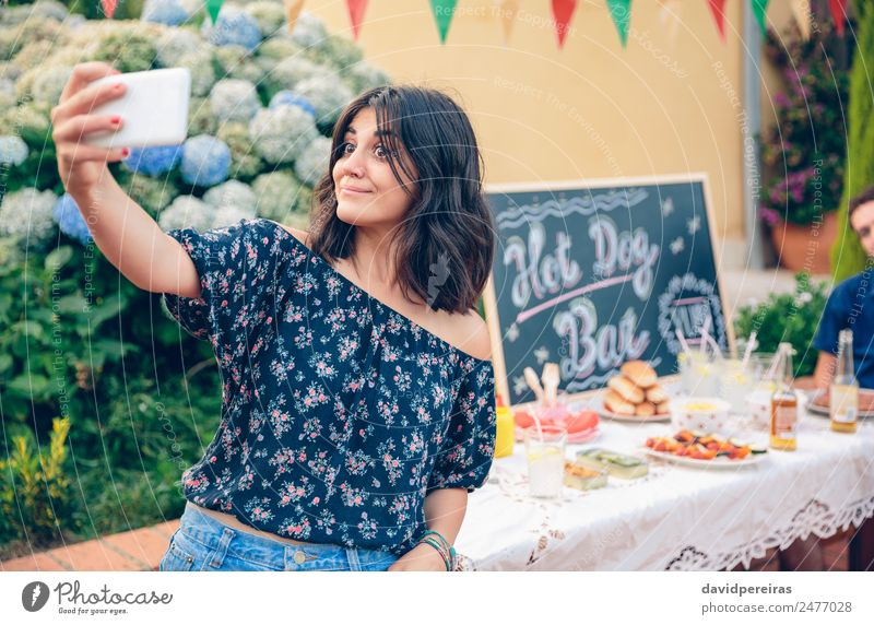 Funny young woman taking a selfie with smartphone Woman Nature Man Summer Joy Adults Lifestyle Laughter Happy Garden Group Friendship Leisure and hobbies