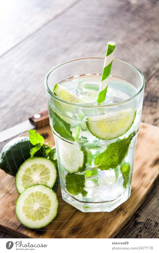 Mojito cocktail Fruit Beverage Alcoholic drinks Spirits Longdrink Cocktail Glass Summer Summer vacation Fresh Cold Sweet Yellow Green Ice Lime Vacation & Travel