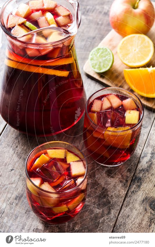 Sangria drink in glass on wood sangria Beverage Drinking Summer Alcoholic drinks Red Fruit Spanish Orange Apple Lemon Lime Delicious Refreshment Cold Ice