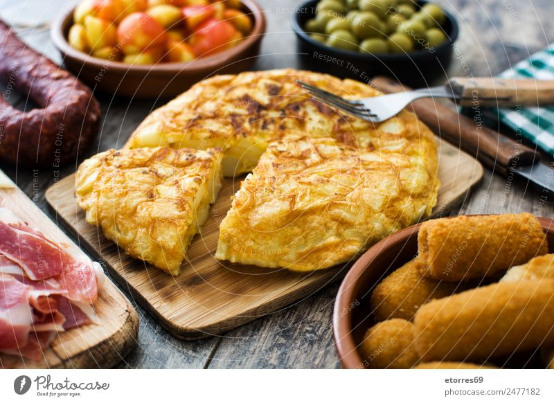 Spanish tapas Food Sausage Fish Vegetable Lunch Dinner Banquet Bowl Fork Good Brown Yellow Green Omelette Tapas Flat bread Olive Potatoes patatas bravas