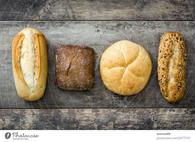 Different breads Healthy Health care Food Exceptional Brown Nutrition Delicious Bread Baked goods Diet Vegetarian diet Wooden table Difference Dough Vegan diet