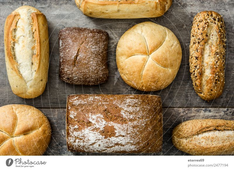 Assorted breads Healthy Food Exceptional Good Bread Baked goods Wooden table Dough Flour Cereal Home-made