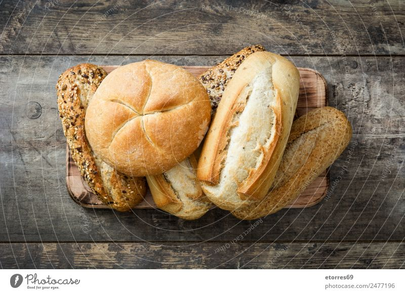 Mixed bread on wooden table Top view Bread Cereal Food Healthy Eating Flour Home-made Breakfast Brown Dinner Bakery Toast Nutrition Organic Consistency Fresh