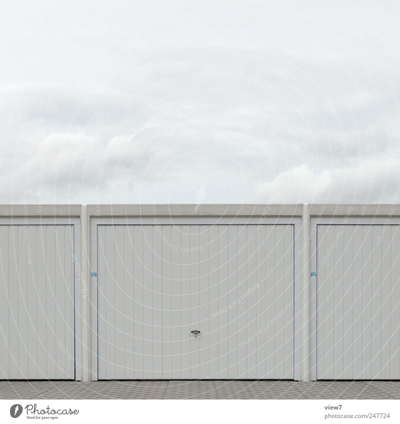 garage Nature Sky Clouds Weather Industrial plant Manmade structures Building Wall (barrier) Wall (building) Facade Door Roof Stone Concrete Metal Line Stripe