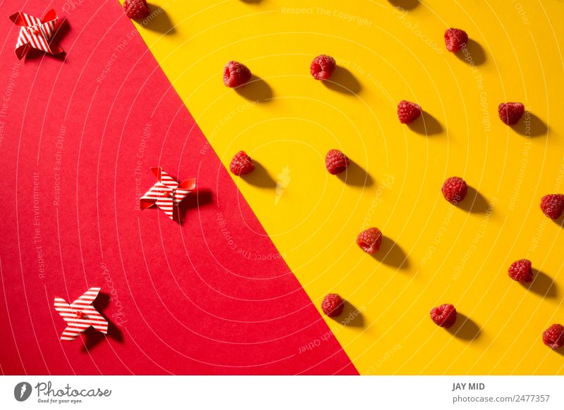 Fresh raspberries on yellow and red background Nature Summer Colour Red Yellow Natural Fruit Nutrition Vantage point Delicious Dessert Mature Berries Bowl Diet