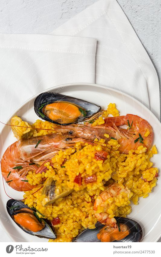 Spanish Traditional rice in paella Food Meat Seafood Vegetable Diet Crockery Plate Healthy Eating Authentic Delicious Sour Paella Rice fish Shellfish Chicken