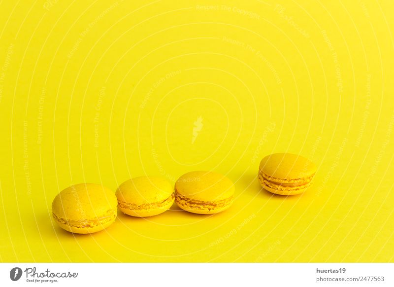 Delicious macaron with yellow background Food Dessert Breakfast Sour Yellow Colour Macaron isolated cake sweet colorful french biscuit Bakery candy snack sugar
