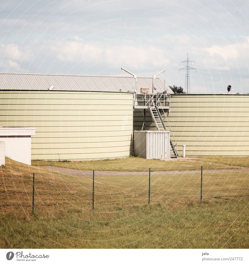 sewage treatment plant Sky Meadow Industrial plant Manmade structures Building Gloomy Blue Yellow White Sewage plant Silo Colour photo Exterior shot Deserted