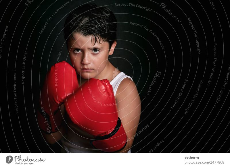 little boy with boxing gloves Lifestyle Sports Martial arts Success Human being Child Boy (child) Infancy 1 8 - 13 years Fitness Aggression Athletic Rebellious