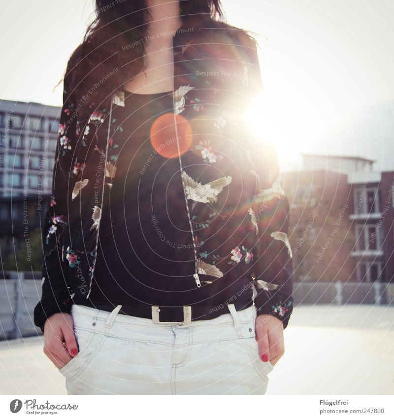 O Feminine Young woman Youth (Young adults) Woman Adults 18 - 30 years Stand Bird Jacket Bag Lens flare Parking garage Sky House (Residential Structure) Sunset