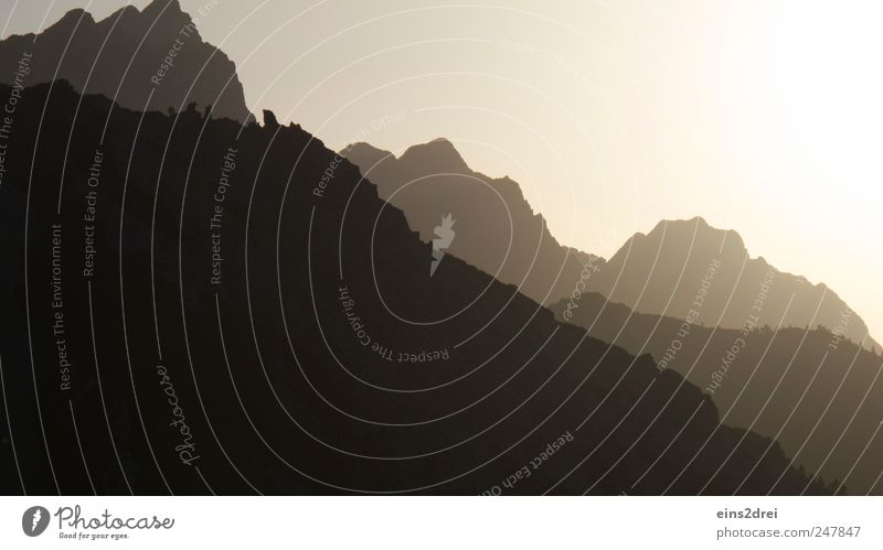 mountain silhouette Relaxation Meditation Vacation & Travel Mountain Climbing Mountaineering Nature Landscape Cloudless sky Sunrise Sunset Beautiful weather