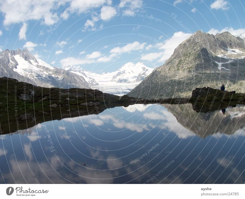Peace and space Mountain lake Glacier Reflection Clouds Landscape Wide angle Aletsch glacier Switzerland mountains