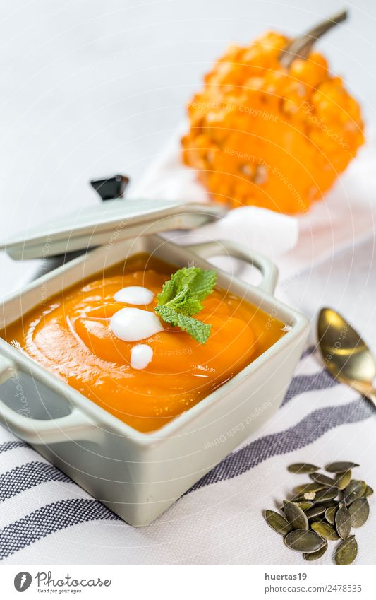 Cream of pumpkin in bowl. Food Vegetable Soup Stew Lunch Dinner Vegetarian diet Diet Plate Bowl Spoon Healthy Healthy Eating Autumn Hot Delicious Sour Yellow