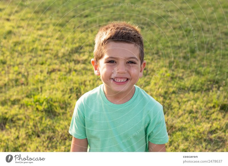 Closeup portrait of adorable sweet child on summer field Child Human being Nature Man Summer Beautiful Green Sun Joy Face Adults Lifestyle Healthy Laughter