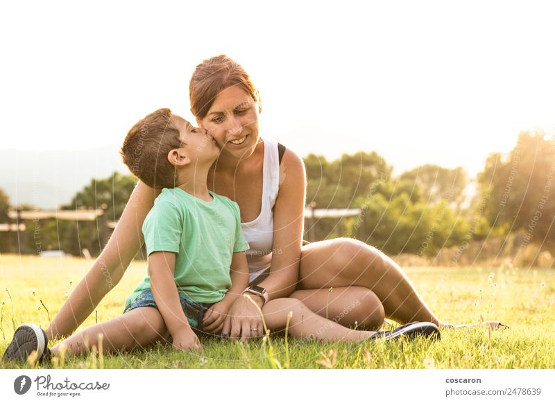 Little boy kissing his mother on a field in summer Lifestyle Vacation & Travel Summer Mother's Day Human being Feminine Child Baby Toddler Boy (child) Woman
