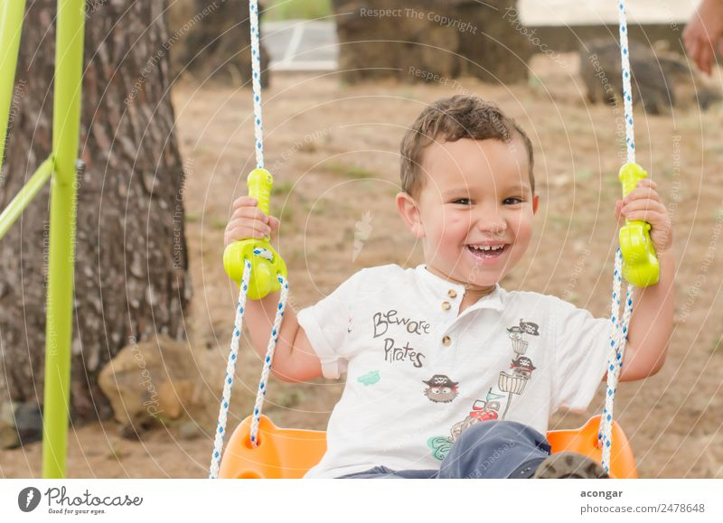 Little boy of 2 years, very smiling, sitting on a swing. Lifestyle Happy Summer Human being Masculine Child Boy (child) Infancy Face 1 1 - 3 years Toddler