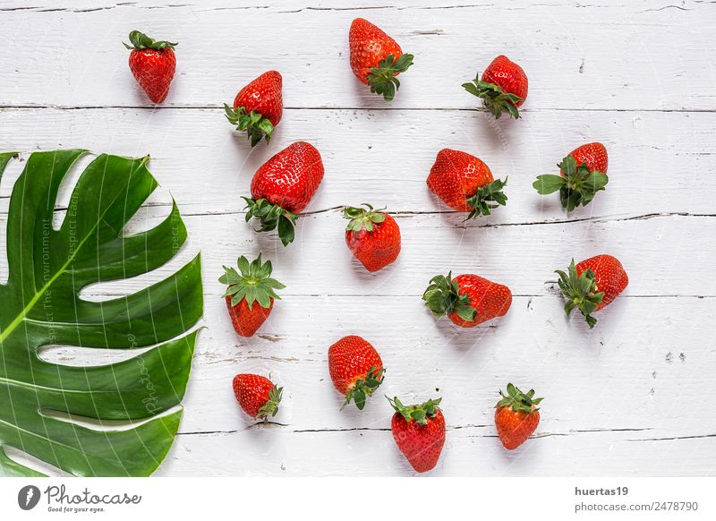 Mix of fresh fruits Food Vegetable Fruit Vegetarian diet Diet Healthy Table Collection Wood Fresh Natural Sour Green Red Strawberry Tropical leaf assortment
