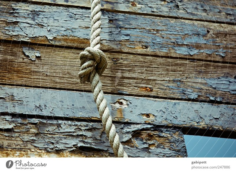 node Fishing boat Watercraft Rope Plank Wood Old Broken Blue Brown Decline Past Transience Change Knot Varnish Flake off Shabby Dye Colour photo Subdued colour