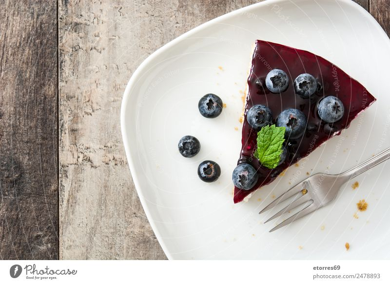 Piece of blueberry cheesecake on wooden table Food Cheese Fruit Cake Dessert Healthy Eating Table Wood Sweet Cheese slice Blueberry Baked goods Candy