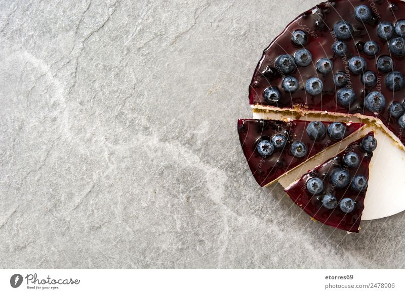 Piece of blueberry cheesecake on gray stone Cheese Blueberry Baked goods Cake Dessert Fruit Sweet Candy Food Healthy Eating Food photograph Baking Creamy
