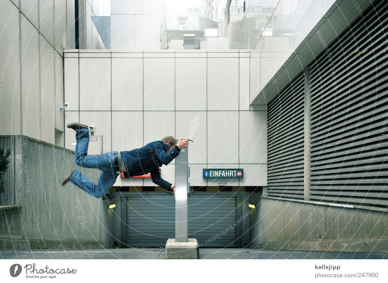 Human being Man House (Residential Structure) Adults Street Architecture Jump Building Door Signs and labeling Masculine Transport High-rise Characters Stop