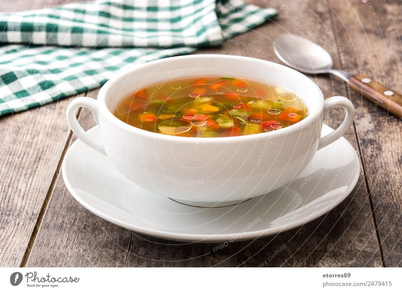 Vegetable soup in bowl on wooden table Healthy Eating Food photograph Wood Nutrition Beverage Drinking Hot Diet Vegetarian diet Vegan diet Carrot Onion Soup