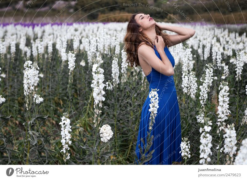 Woman posing in field of white flowers Lifestyle Adults 18 - 30 years Youth (Young adults) Garden Fashion Green White