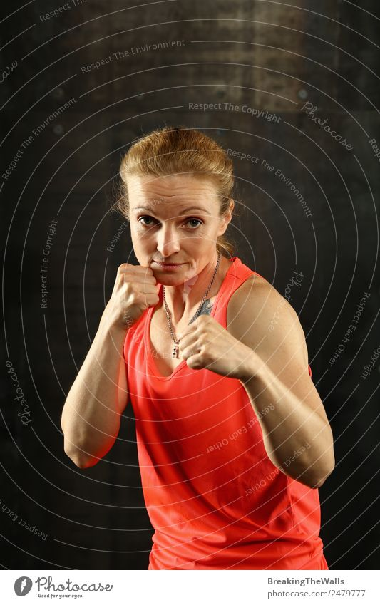 Woman standing in boxing stance ready to fight Lifestyle Sports Fitness Sports Training Martial arts Track and Field Sportsperson Success Young woman