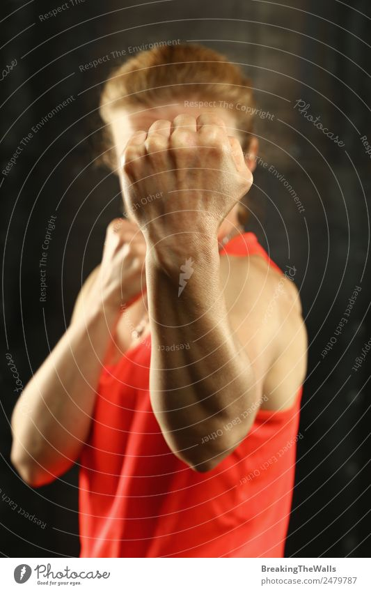 Portrait of woman shadow boxing Woman Human being Youth (Young adults) Young woman White Hand Dark 18 - 30 years Black Adults Sports Blonde Action Arm Fitness