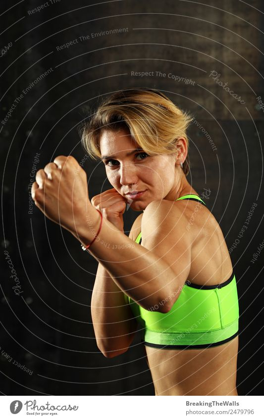 Boxer woman punching with fist in fight Lifestyle Sports Fitness Sports Training Martial arts Track and Field Sportsperson Young woman Youth (Young adults)