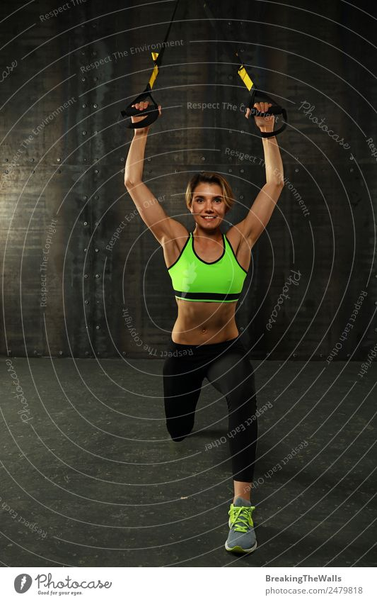 Young woman training with trx fitness straps Lifestyle Athletic Sports Fitness Sports Training Track and Field Sportsperson Youth (Young adults) Woman Adults