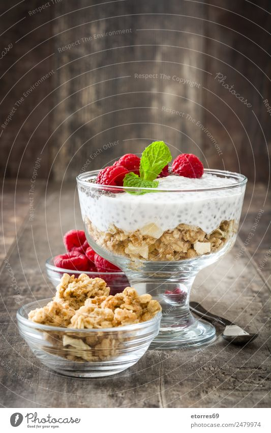 Chia yogurt with raspberries in a glass cup on wood chia Yoghurt Raspberry Dairy Fruit Healthy Healthy Eating Vegan diet Vegetarian diet superfood Natural